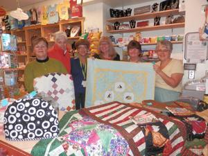 guild members present quilted items for sale to hospital gift shop